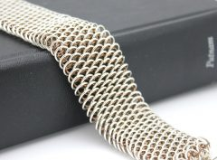 dragonscale-on-book-flat-close-up